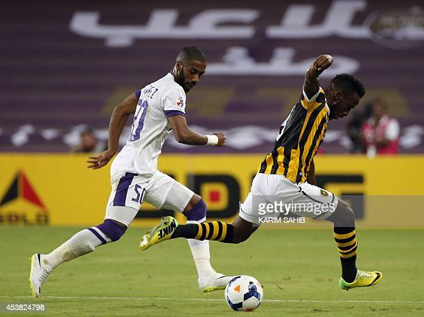 UAE's AlAin's defender Mohammed Fayez defende against Saudi's AlIttihad forward Fahad AlMuwallad during their AFC Champions League football match on...