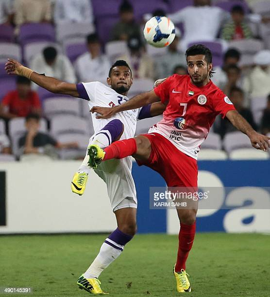 UAE's alAin's Mohamed Ahmed vies for the ball with UAE's alJazira Ali Mabkhout during the second leg of their AFC Champions League football match on...