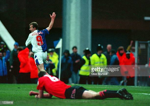 BLACKBURN's ALAN SHEARER CELEBRATES HIS SECOND GOAL DURING THEIR FA PREMIERSHIP MATCH AGAINST MANCHESTER UNITED AT EWOOD PARK BLACKBURN ROVERS WON...