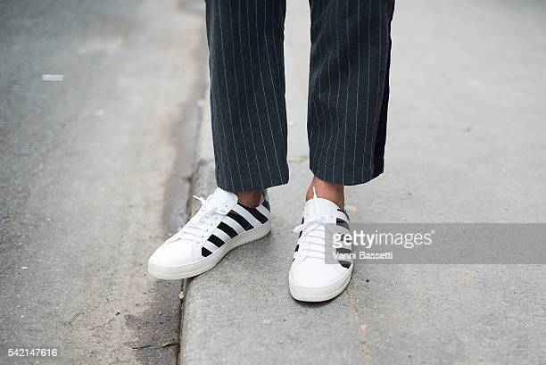 WWD's Alex Badia poses earing Sacai pants and OFF White shoes after the Lemaire show at the Palais de la Femme during Paris Menswear fashion week...