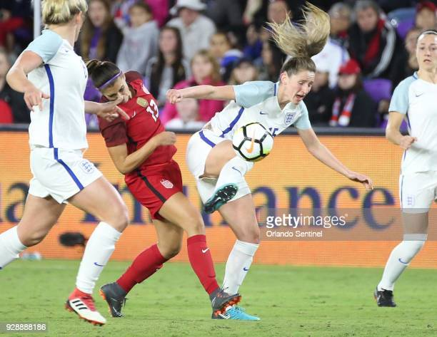 USA's Alex Morgan collides with England's Abby McManus during the She Believes Cup at Orlando City Stadium on Wednesday March 7 in Orlando Fla