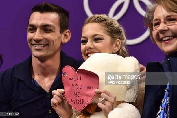 S Alexa Scimeca Knierim holds a Valentine's Day note that came with a stuffed toy after she and partner USA's Chris Knierim competed in the pair...