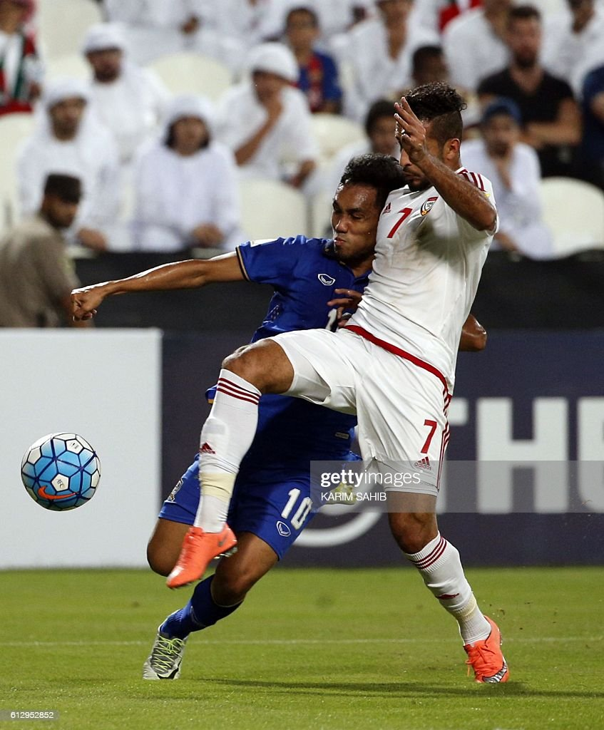 UAE's Ali Ahmed Mabkhout (R) vies with thalaind 's Teerasil Dangda (L) during their World Cup 2018 Asia qualifying football match United Arab Emirates versus Talaind on at the Mohammed Bin Zayed Stadium in Abu Dhabi. October 5, 2016 / AFP / KARIM