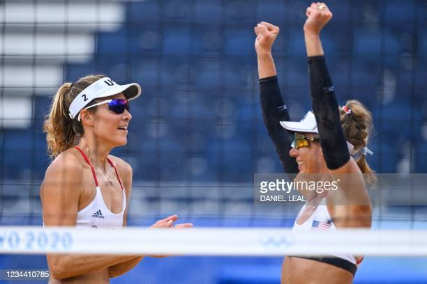 S Alix Klineman celebrates winning with partner April Ross after their women's beach volleyball quarter-final match between Germany and the USA...
