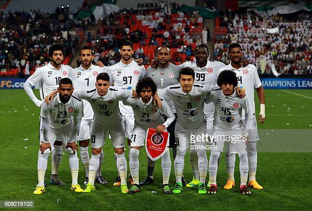 UAE's AlJazeera starting eleven pose for a team photo prior to the start of their AFC Champions League third round qualifying football match against...