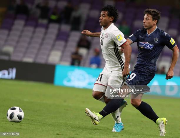 UAE's alJazira club player Romarinho and Auckland City's Darren White vie for the ball during their FIFA Club World Cup UAE 2017 first round football...