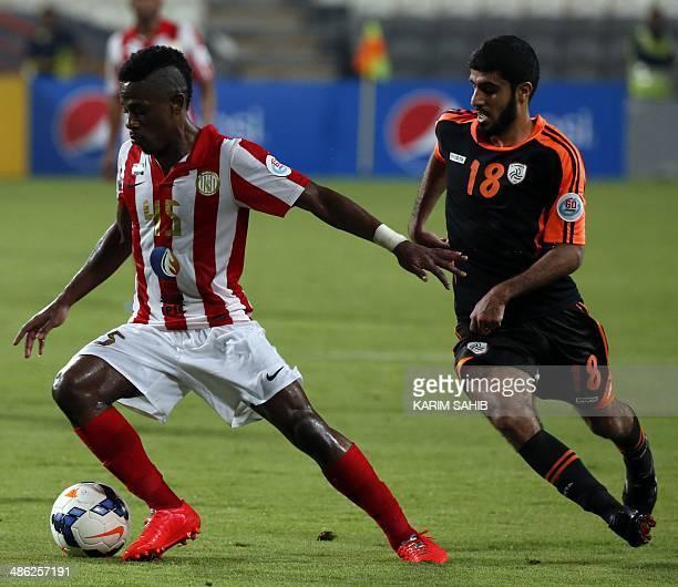 UAE's alJazira forward Ahmed Rabeea dribbles past Saudi's alShabab midfielder Abdulmajeed AlRuwaili during their AFC Champions League at the Mohammed...