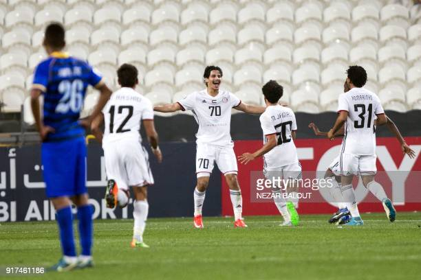 UAE's AlJazira's Ahmed Husain celebrates after scoring against Qatar's alGharafa's Fahid Al Shammari during the AFC Champions League Round 1 Group...