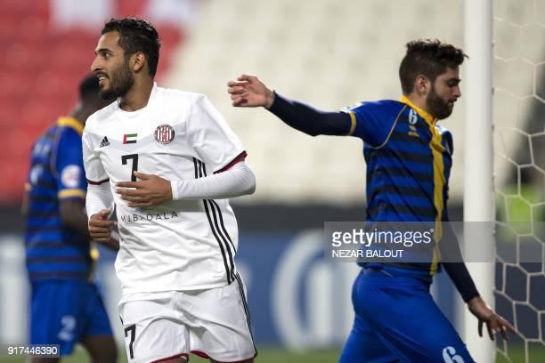 UAE's AlJazira's Ali Ahmed Mabkhout celebrates after scoring against Qatar's alGharafa's Rubert Fasciana during the AFC Champions League Round 1...