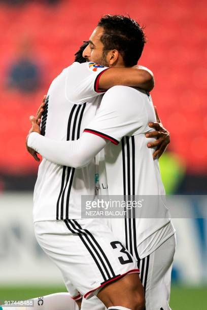 UAE's AlJazira's Ali Ahmed Mabkhout celebrates after scoring against Qatar's alGharafa's team during the AFC Champions League Round 1 Group Match...