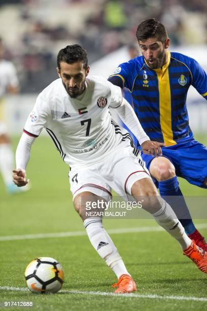 UAE's AlJazira's Ali Ahmed Mabkhout fights for the ball against Qatar's alGharafa's Rubert Quijada Fasciana during the AFC Champions League Round 1...