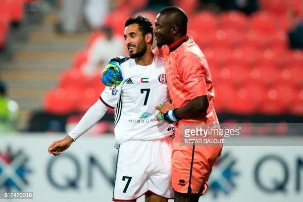 UAE's AlJazira's Ali Ahmed Mabkhout hugs Qatar's alGharafa's Goalkeeper Qasem Abdullhamed Burhan during the AFC Champions League Round 1 Group Match...