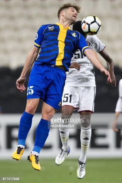 UAE's AlJazira's Khalifa Mubarak Alhammadi fights for the ball against Qatar's alGharafa's Diogo Carlos Amado during the AFC Champions League Round 1...