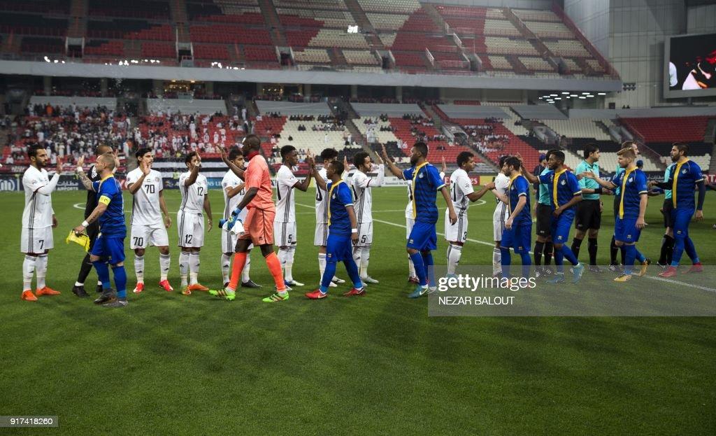 UAE's Al-Jazira's players greet Qatar's al-Gharafa's players ahead of the AFC Champions League Round 1 Group (A) Match between al-Jazira vs al-Gharafa at the Mohammed Bin Zayed Stadium in abu Dhabi on February 12, 2018. /