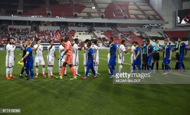 UAE's AlJazira's players greet Qatar's alGharafa's players ahead of the AFC Champions League Round 1 Group Match between alJazira vs alGharafa at the...