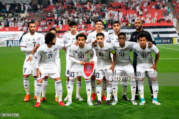 UAE's AlJazira's players pose for a group photo ahead of the AFC Champions League Round 1 Group Match between alJazira vs alGharafa at the Mohammed...