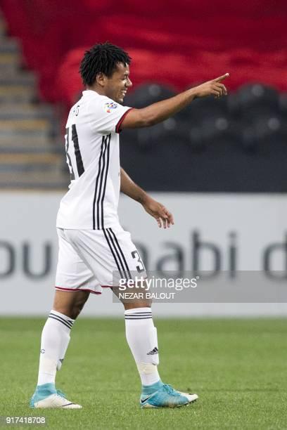 UAE's AlJazira's Romario Ricardo Silva celebrates after scoring against Qatar's alGharafa team during the AFC Champions League Round 1 Group Match...