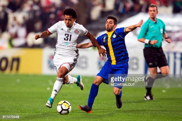 UAE's AlJazira's Romario Ricardo Silva vies for the ball against Qatar's alGharafa's Yousuf Muftah during the AFC Champions League Round 1 Group...