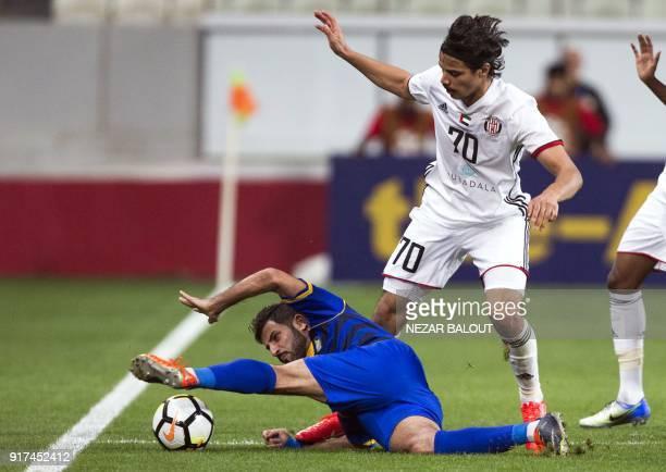 UAE's AlJazira'sAhmed Husain fights for the ball against Qatar's alGharafa's Fahid Al Shammari during the AFC Champions League Round 1 Group Match...