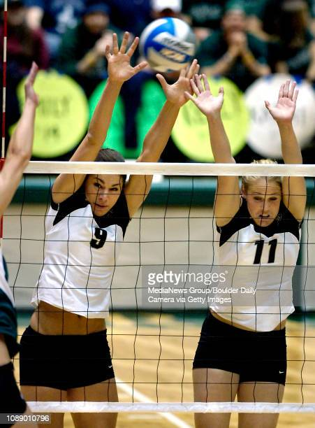 CU's Allie Griffin and Lara Bossow try to block a CSU hit during their match in the first round of the NCAA Volleyball Championship at Moby Arena in...