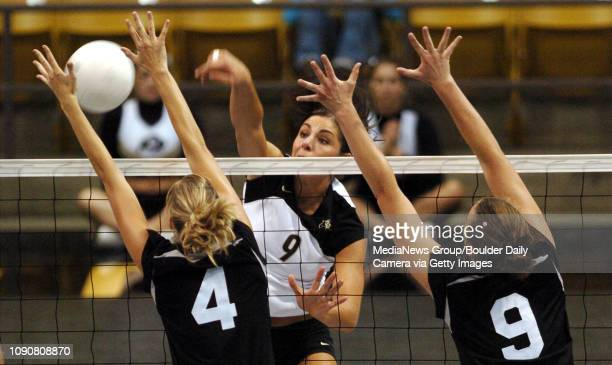 CU's Allie Griffin spikes the ball past the arms of KSU's Lisa Martin and Gabby Guerre
