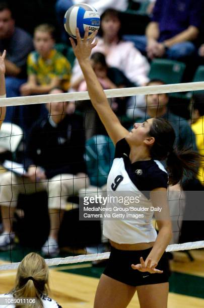 CU's Allie Griffin tips the ball over the net against CSU during the Buffs three games to one loss in the first round of the NCAA Volleyball...