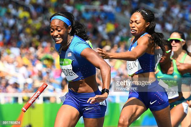 USA's Allyson Felix attempts to hand the baton to USA's English Gardner in the Women's 4 x 100m Relay Round 1 during the athletics event at the Rio...