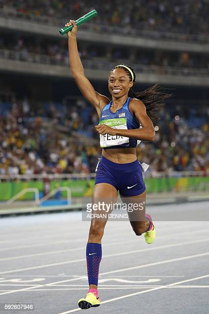 USA's Allyson Felix celebrates winning the Women's 4x400m Relay Final during the athletics event at the Rio 2016 Olympic Games at the Olympic Stadium...