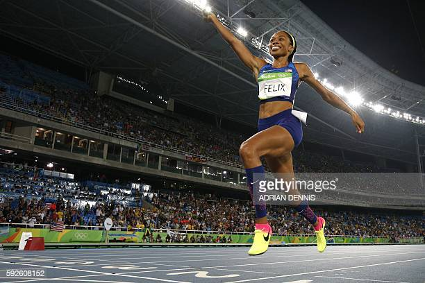 TOPSHOT USA's Allyson Felix celebrates winning the Women's 4x400m Relay Final during the athletics event at the Rio 2016 Olympic Games at the Olympic...