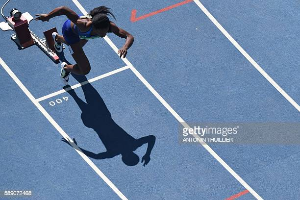 USA's Allyson Felix competes in the Women's 400m Round 1 during the athletics event at the Rio 2016 Olympic Games at the Olympic Stadium in Rio de...