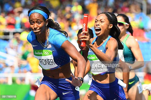 USA's Allyson Felix hands the baton to USA's English Gardner competes in the Women's 4 x 100m Relay Round 1 during the athletics event at the Rio...