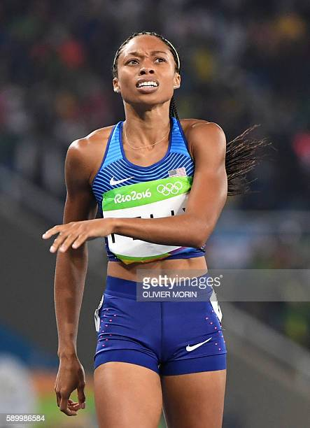 USA's Allyson Felix looks at the results board after she competed in the Women's 400m Final during the athletics event at the Rio 2016 Olympic Games...