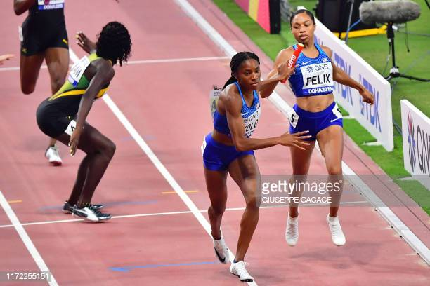 USA's Allyson Felix passes the baton to USA's Courtney Okolo in the Mixed 4 x 400m Relay final at the 2019 IAAF World Athletics Championships at the...