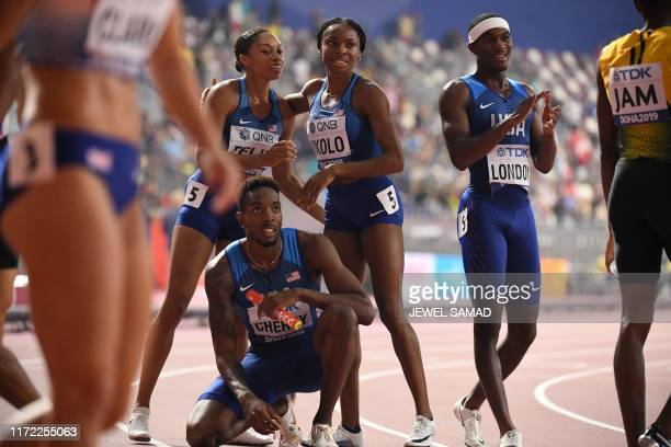 USA's Allyson Felix USA's Michael Cherry USA's Courtney Okolo and USA's Wilbert London celebrate after winning the Mixed 4 x 400m Relay final at the...