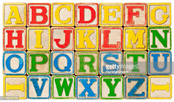 abc's, alphabet spelled out with antique toy blocks. - font stock pictures, royalty-free photos & images