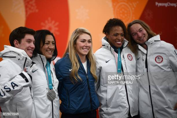 USA's alpine skiing medallist Mikaela Shiffrin poses for a picture with other US medallists freestyle skiers Alex Ferreira and David Wise and...
