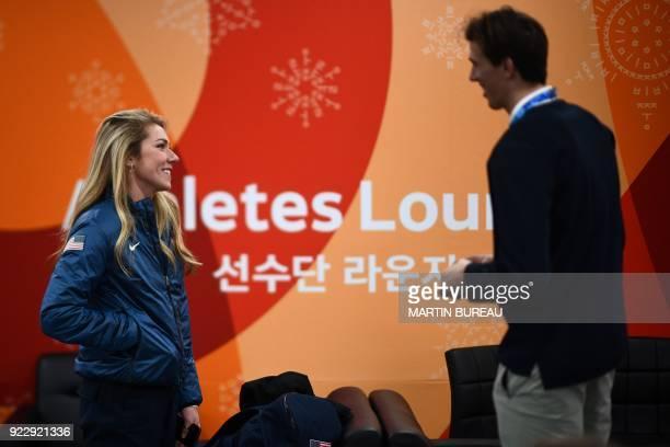 USA's alpine skiing medallist Mikaela Shiffrin speaks with Switzerland's alpine skiing medallist Ramon Zenhaeusern backstage at the Athletes' Lounge...
