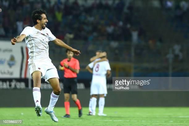UAE's AlWahda player Tariq Al Khadim do a victory lap after defeating AlAin during the Arabian Gulf Super Cup match between Emirati teams AlWahda and...