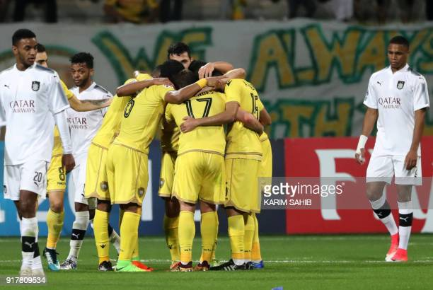 UAE's AlWasl's players celebrate after scoring a goal during the AFC Champions League group stage football match between alWasl and alSadd at the...