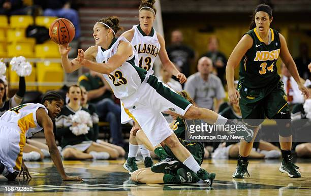 UAA's Alysa Horn gets rid of the ball as she falls to the court UAA defeated North Dakota State 7347 in the opening round of the 2012 Women's Great...