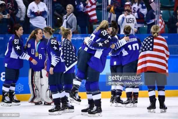 TOPSHOT USA's Amanda Kessel is hugged by teammate Lee Stecklein after the medal ceremony after the US team won the gold in the women's ice hockey...