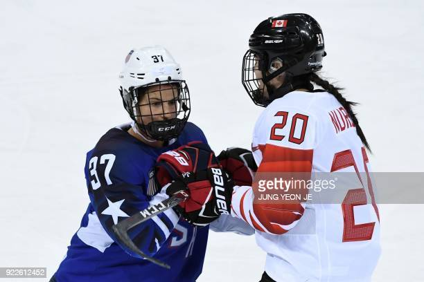 USA's Amanda Pelkey and Canada's Sarah Nurse fight in the women's gold medal ice hockey match between the US and Canada during the Pyeongchang 2018...