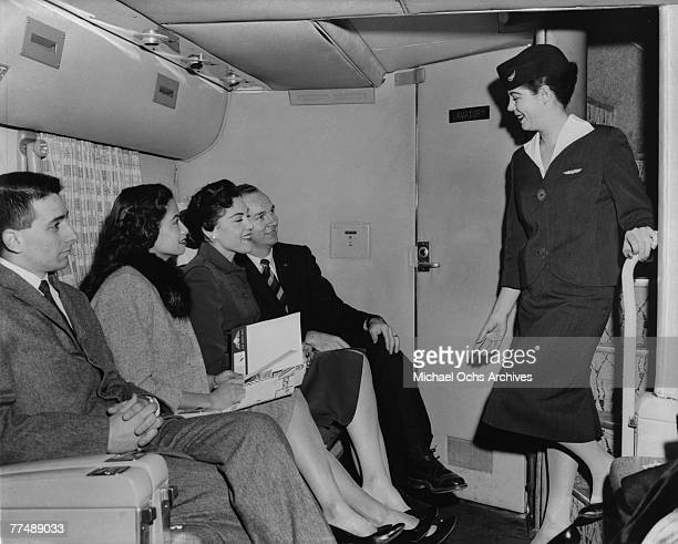 NEW YORK MID 1950's An air hostess chats with passengers on a Transocean Air lines Boeing 377 Stratocruiser in the mid 1950's Transocean Air lines...