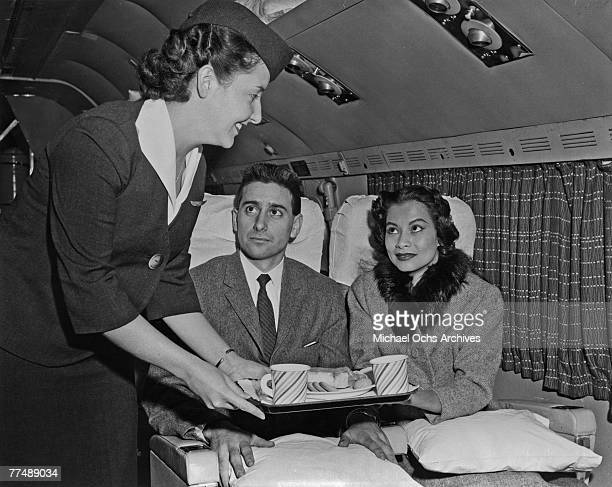 NEW YORK MID 1950's An air hostess serves a snack to passengers on a Transocean Air lines Boeing 377 Stratocruiser in the mid 1950's Transocean Air...