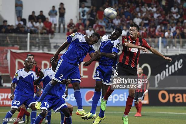 USMA's and AlHilal's players vie for the ball during Halffinal of the CAF Champion's League football match between USMA Algiers and Al Hilal of Sudan...