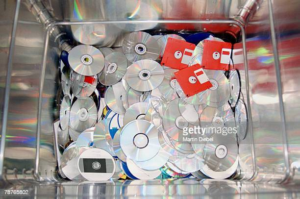 CD's and floppy disks in a metal container