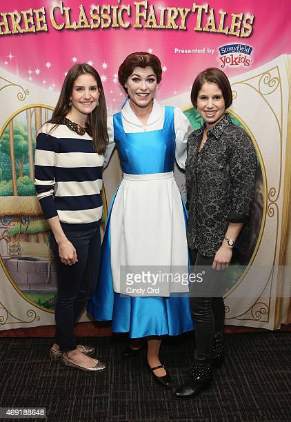 EVP's and Producers for Feld Entertainment sisters Alana Feld and Nicole Feld pose for a photo with Princess Belle at The Moms 'Disney Live'...