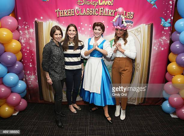 EVP's and Producers for Feld Entertainment sisters Alana Feld and Nicole Feld pose for a photo with Princess Belle and TV/ radio personality Denise...