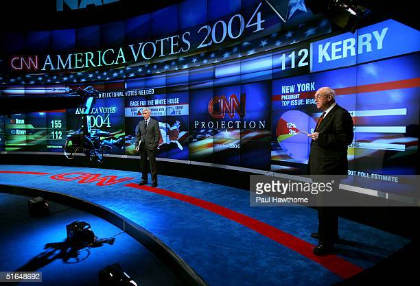 S Anderson Cooper and William Schneider speak during the election night results program at the NASDAQ building in Times Square November 2, 2004 in...