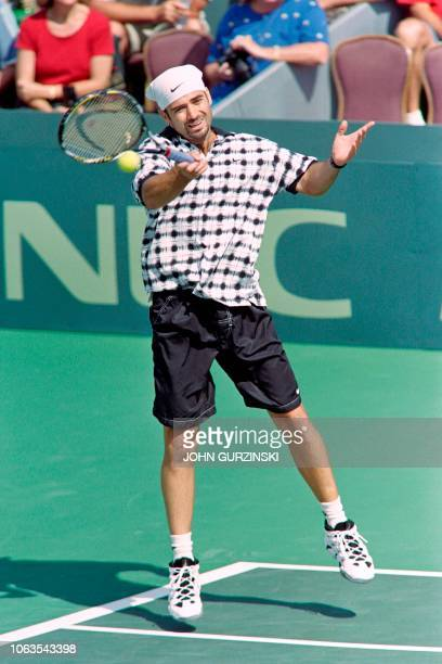 USA's Andre Agassi returns the ball against Sweden's Matts Wilander during the tennis match of the Davis Cup semifinal between US and Sweden on...